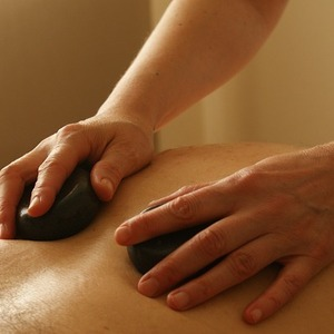 Ease Your Sore Muscles With a Hot Stone Massage